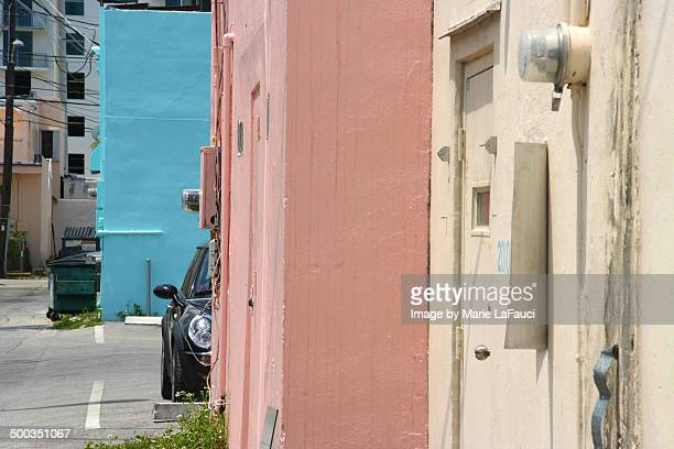 street buildings painted blue, pink and tan - fauci stock pictures, royalty-free photos & images