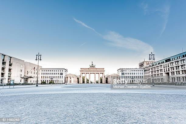 street by brandenburg gate against sky - berlin stock pictures, royalty-free photos & images