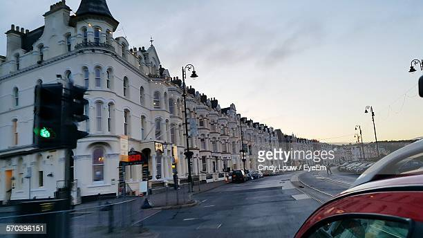 Street By Buildings Against Sky At Sunset