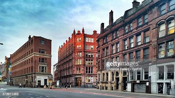 street by buildings against sky - north west england stock pictures, royalty-free photos & images