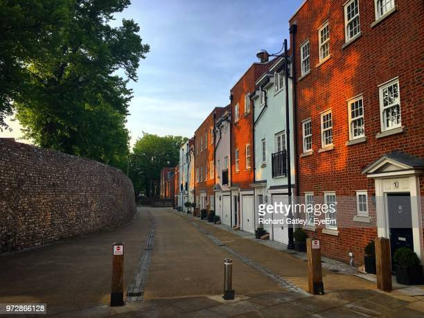 street by buildings against sky - chichester stock pictures, royalty-free photos & images