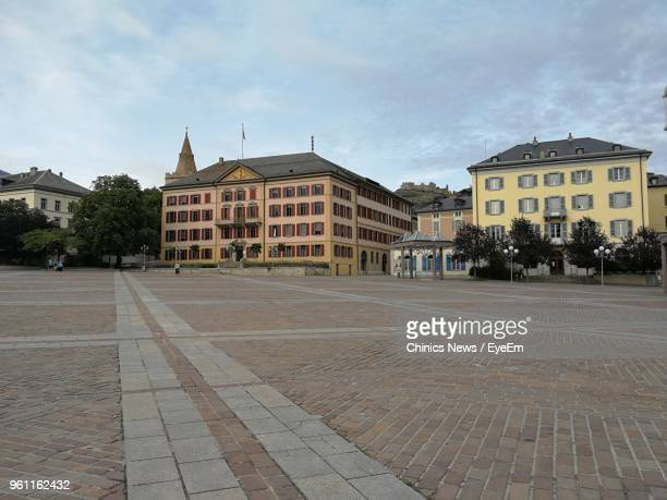 street by buildings in town against sky - sion switzerland stock pictures, royalty-free photos & images