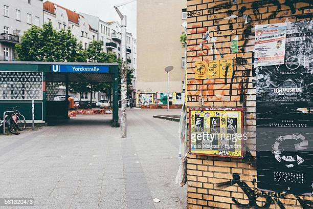 street by graffiti wall leading towards buildings in city - kreuzberg stock photos and pictures