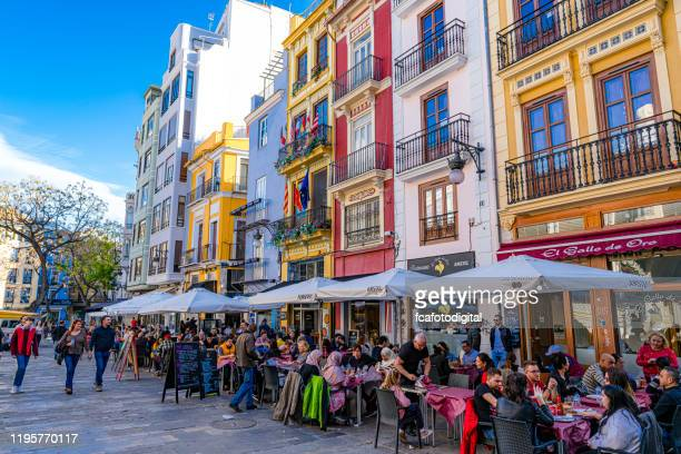 street cafe and restaurants near mercado central-valencia, spain - valencia spain stock pictures, royalty-free photos & images