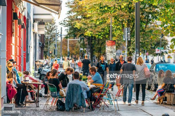 street cafe in berlin, germany - kreuzberg stock photos and pictures