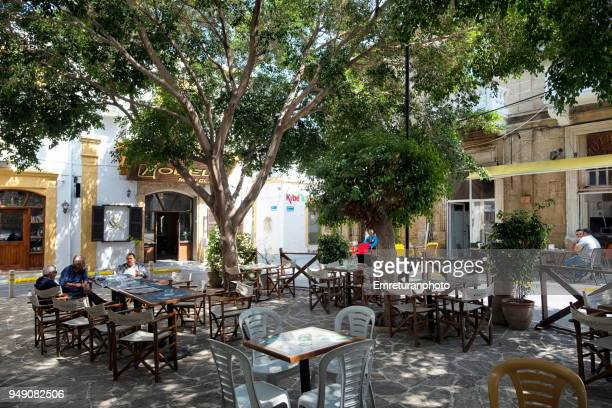 a street cafe with customers in girne. - emreturanphoto stock pictures, royalty-free photos & images