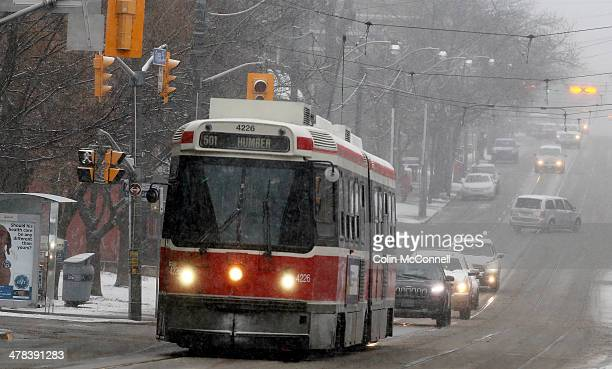 A street car makes its way along Queen St East in the snowstorm After getting high temperatures of about 10 degrees yesterday the GTA is being hit...
