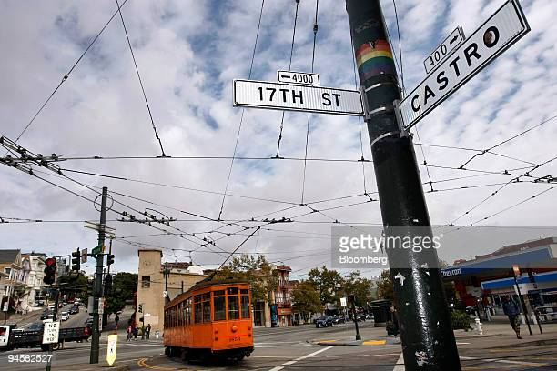 A street car passes through the intersection of Castro and 17th Streets in the heart of the Castro district in San Francisco California US on...