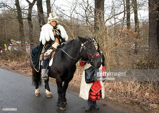 Street carnival in Cologne with female rider