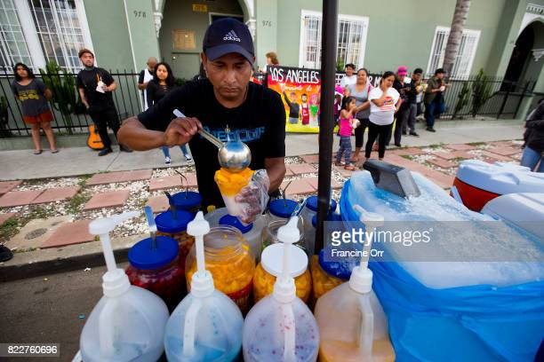JULY 25 2017 Street cart vendor Alex Ramirez serves up ice and fruit in Hollywood close to the area where his son Benjamin Ramirez had his cart...