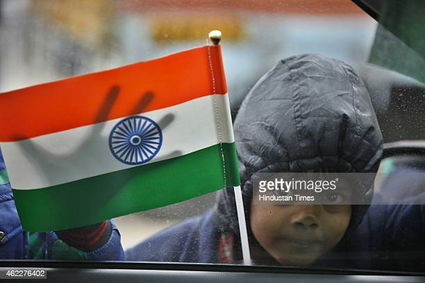 A street child selling Indian flag at India Gate after the ceremony of 66th Republic Day of India on January 26 2015 in New Delhi India President of...