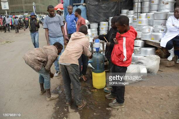 Street children at Gikomba Market in Nairobi wash their hands with liquid soap as a preventive measure against covid19 The Kenyan government has...