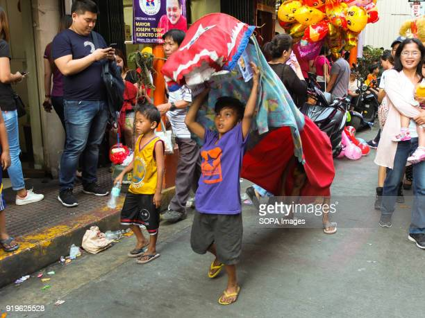 CHINATOWN MANILA PHILIPPINES Street children imitating the traditional dance by using curtain cloth or beddings Filipinos celebrated the Chinese New...