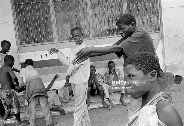 Street children playing in the city centre of the Angolan capital Luanda on December 2002 There are thought to be at least 10000 street children in...