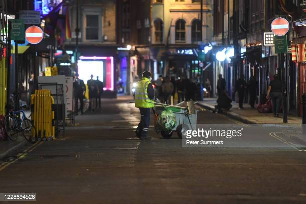 Street cleaner cleans the streets in Soho on September 24, 2020 in London, England. Pubs, cafes and restaurants will have to shut at 10pm every night...