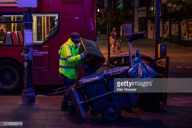 A street cleaner continues to work on Brixton High Street on March 26 2020 in London England British Prime Minister Boris Johnson announced strict...