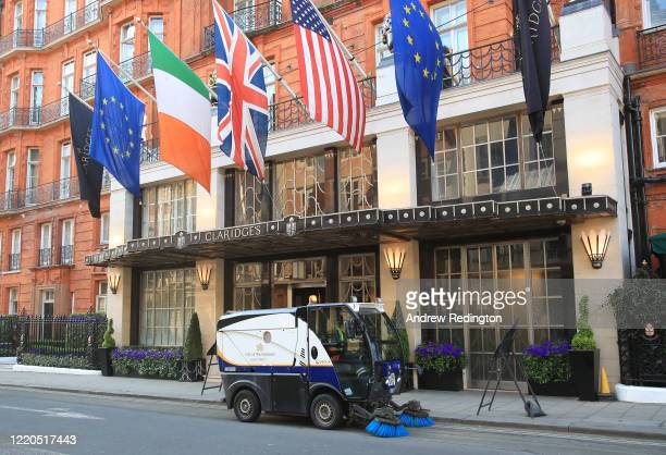 Street cleaner is pictured outside the closed up Claridge's hotel on April 23, 2020 in London, England. The British government has extended the...