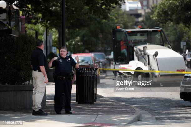 A street cleaner runs along the crime scene as police wrap up their investigation after a mass shooting in a popular nightlife district on August 04...