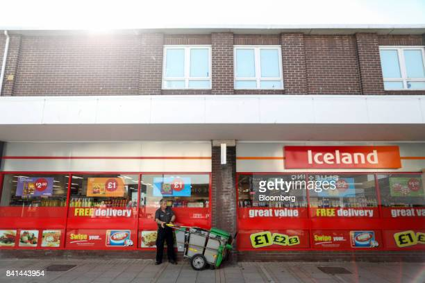 A street cleaner stands outside an Iceland Foods Ltd store in the Vancouver Quarter openair mall King's Lynn UK on Tuesday Aug 29 2017 In the town of...