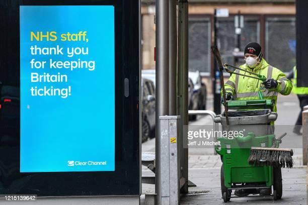 A street cleaner walks down Cochrane Street on March 27 2020 in Glasgow ScotlandScotland First Minister of Scotland Nicola Sturgeon along with...