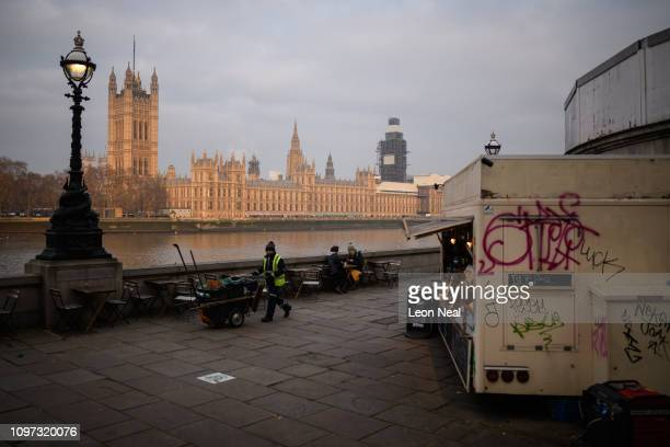 A street cleaner walks near the Houses of Parliament as the week begins on January 21 2019 in London England British Prime Minister Theresa May is...