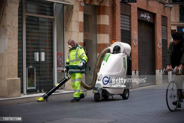 A street cleaner wears a face mask On Monday March 16th French President Macron announced that all people will be on lockdown due to the Covid19...
