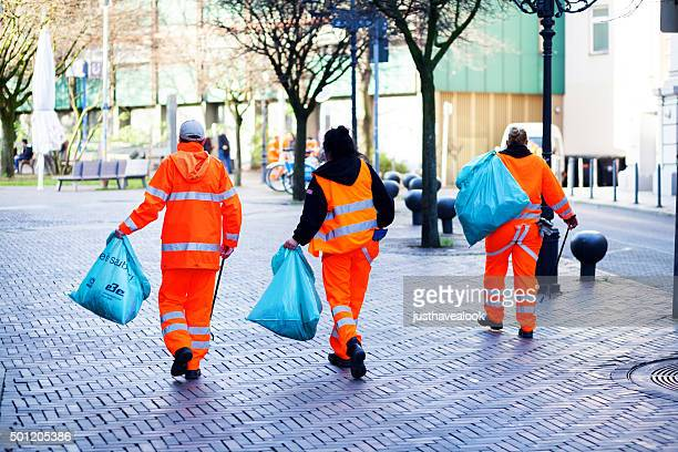 street cleaners at work in winter - street sweeper stock pictures, royalty-free photos & images