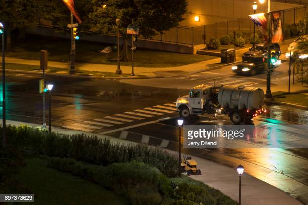 a street cleaning vehicle in action. - street sweeper stock pictures, royalty-free photos & images