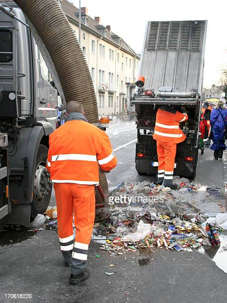 Street cleaning with garbage trucks