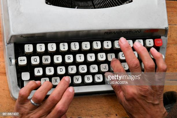 Street clerk Candelaria Pinilla types a letter on her typewriter in front of the district taxing office in Bogota on April 9 2018 Street clerks are...