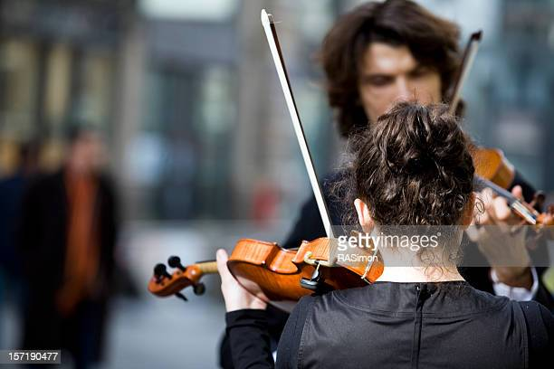 a street concerto with violins - vienna austria stock pictures, royalty-free photos & images