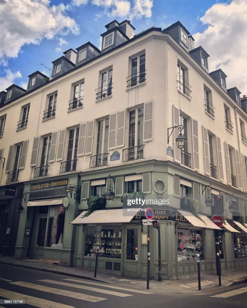 Street corner with famous La Duree bakery and cafe in Paris, France : Stock Photo