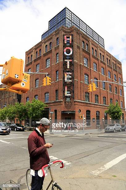 A street corner with Wythe Hotel in background