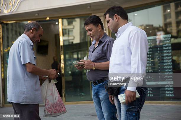 Street currency traders counts out rial banknotes while doing a deal with a customer left in Tehran Iran on Wednesday Aug 26 2015 The nuclear...