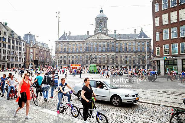 Street Damrak and Royal Palace in Amsterdam