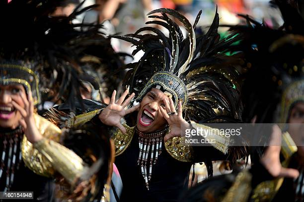 A street dancer performs during the annual Grand Santo Nino Procession in Manila on January 27 2013 The annual Grand Santo Nino Procession features...
