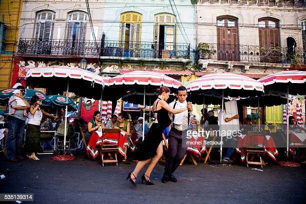 Street dancers dance the tango in Caminito of La Boca in Buenos Aires
