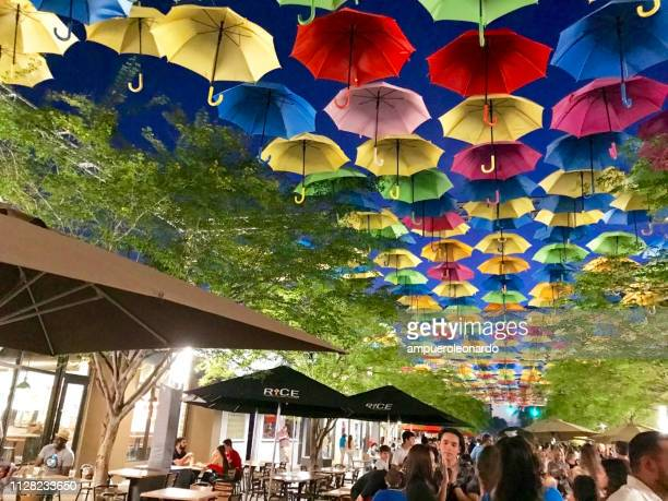 street decorated with colored and open umbrellas in miami, usa - miami dade county stock photos and pictures