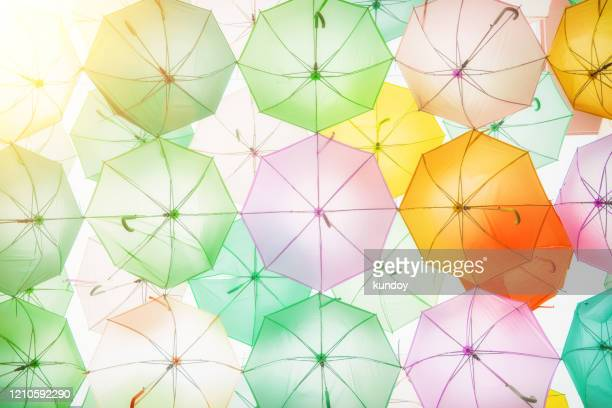 street decorated with colorful umbrellas with sunlight, bangkok, thailand. vintage background. - editorial stock pictures, royalty-free photos & images