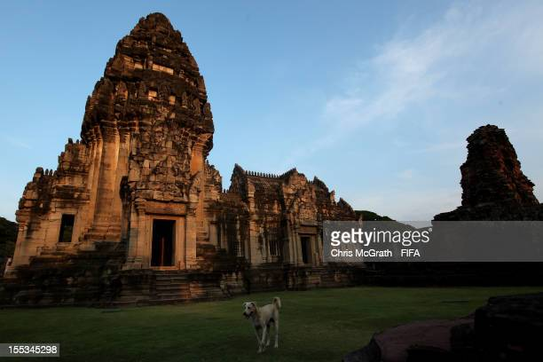 A street dog walks in front of the temple at Phimai Sanctuary on November 3 2012 in Phimai District Nakhon Ratchasima ThailandThe Khmer ruins are...