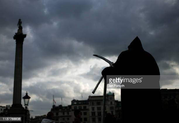 A street entertainer acts as the Grim Reaper as thousands of demonstrators take to the streets of London during the People's Vote March on March 23...