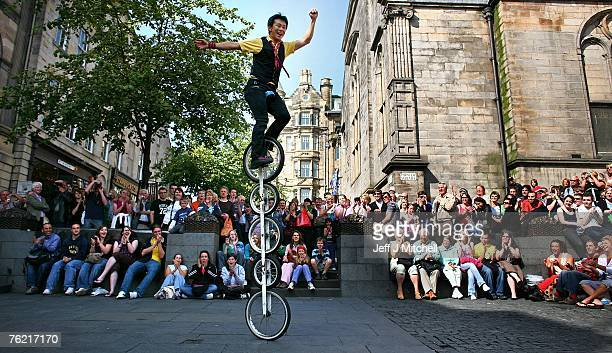 Street entertainers perform on the Royal Mile during the Edinburgh Fringe Festival August 22 2007 in Edinburgh Scotland
