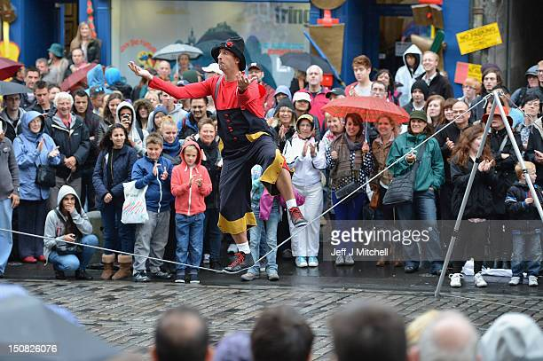 Street entertainers perform on the Royal Mile on the final day of the Edinburgh Festival Fringe on August 27 2012 in Edinburgh Scotland The Edinburgh...