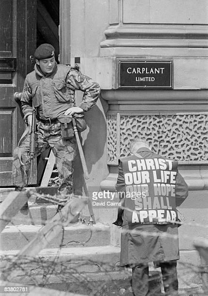 A street evangelist approaches a British soldier in Northern Ireland 29th June 1972