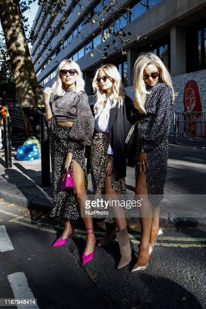 Street fashion as visitors attend London Fashion Week show at British Fashion Council show space in London, England on September 13, 2019.