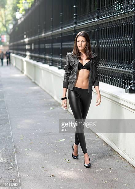 street fashion - black trousers stock photos and pictures