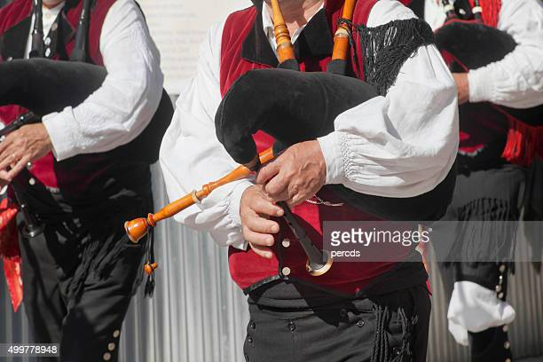street folk band, pipers walking, traditional clothings. - traditional musician stock photos and pictures