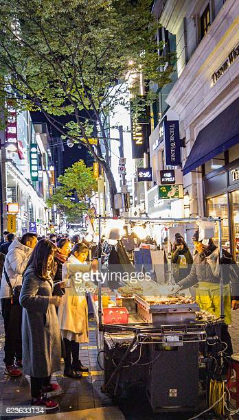 street food at myeongdong, seoul, korea - vsojoy stock pictures, royalty-free photos & images