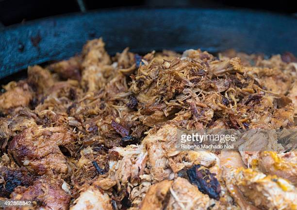 DOWNTOWN TORONTO ONTARIO CANADA Street Food at the Toronto International Buskerfest 2015 Closeup of well cooked and disintegrated meat The meat is...