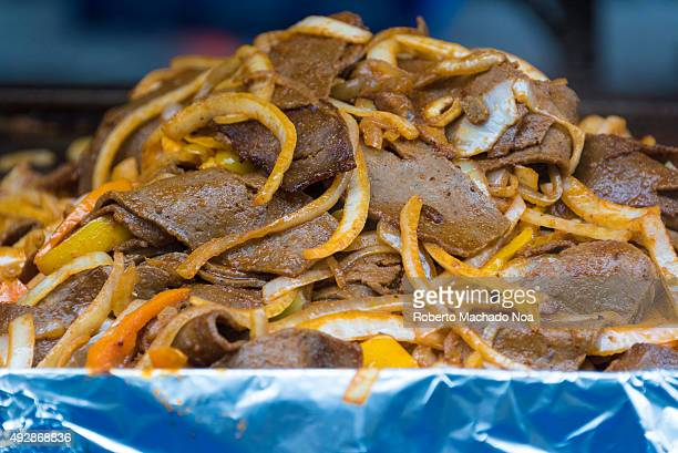 DOWNTOWN TORONTO ONTARIO CANADA Street Food at the Toronto International Buskerfest 2015 Thin and long slices of meat cooked in spices and oil...